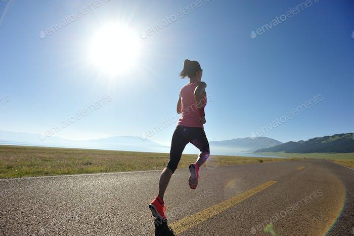Runner running on highway