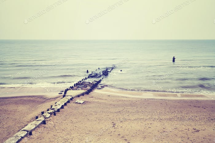 Retro toned picture of a beach, Baltic Sea coast, Poland.