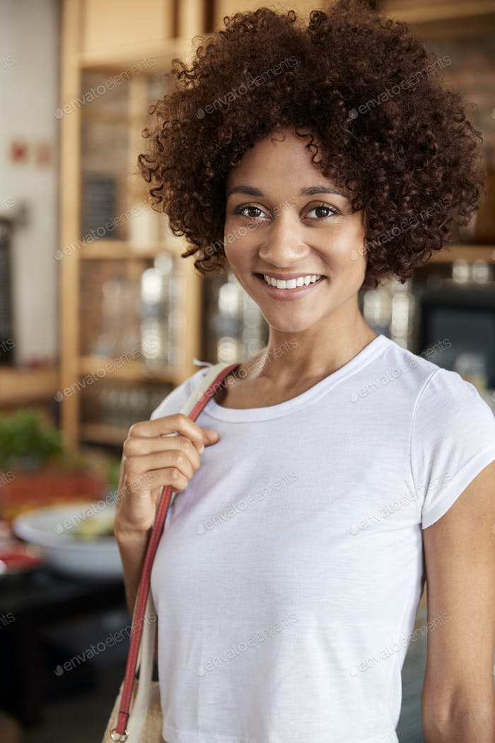 Portrait Of Woman Shopping In Sustainable Plastic Free Grocery Store