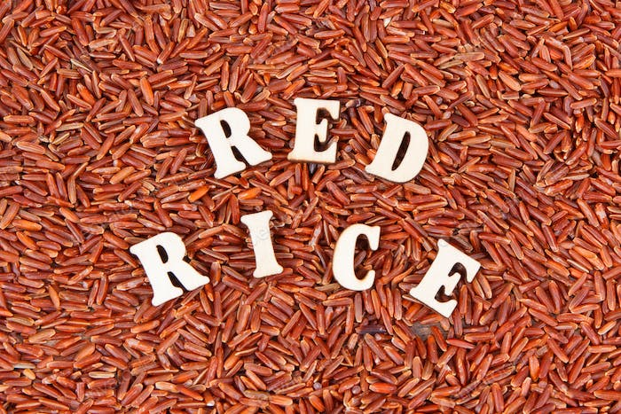 Heap of red rice as background, healthy gluten free food concept