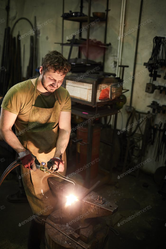 Man working in smithy