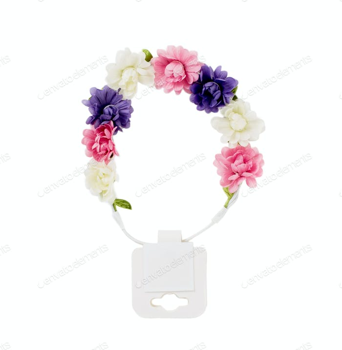 Hair band with artificial flowers.