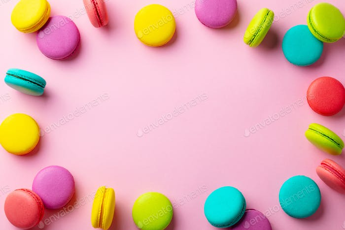 Macaroons Dessert on Pink Pastel Background. Copy Space. Top view.