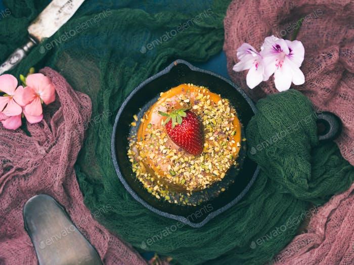 Caramel cake with strawberry pistachio flowers