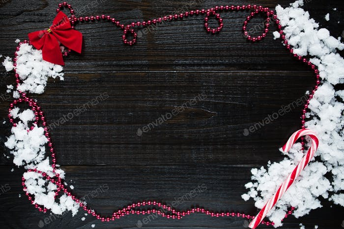 Christmas decoration closeup on black wooden table