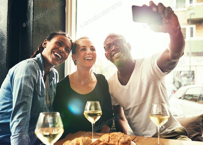Three ethnic friends taking a selfie