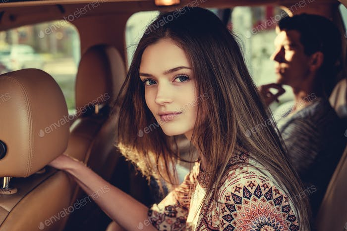 Portrait of young  female in a car.