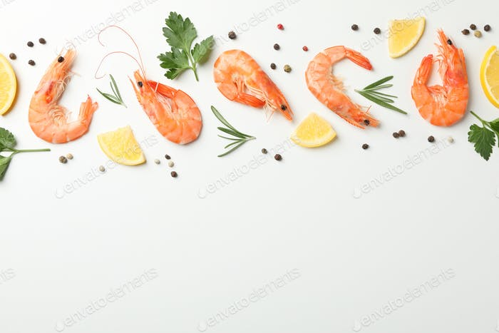 Flat lay with shrimps and spices on white background, top view