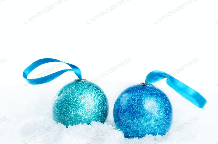 Christmas colored balls on snow isolated background