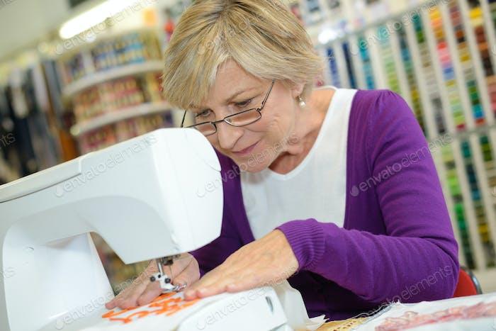 woman sewing using a sewing machine