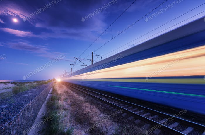 High speed passenger train in motion on the railroad at night