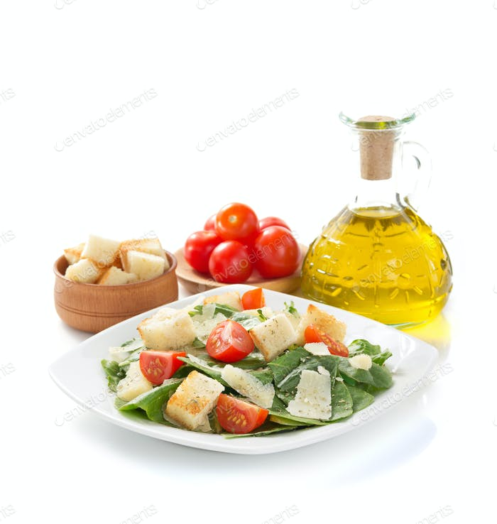 caesar salad in plate on white background