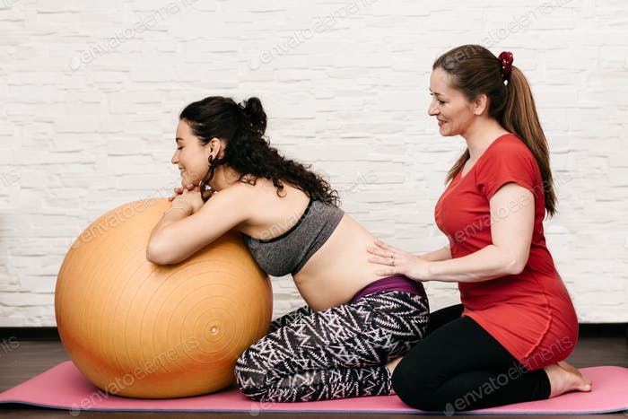 Relieving back pain at pregnancy.
