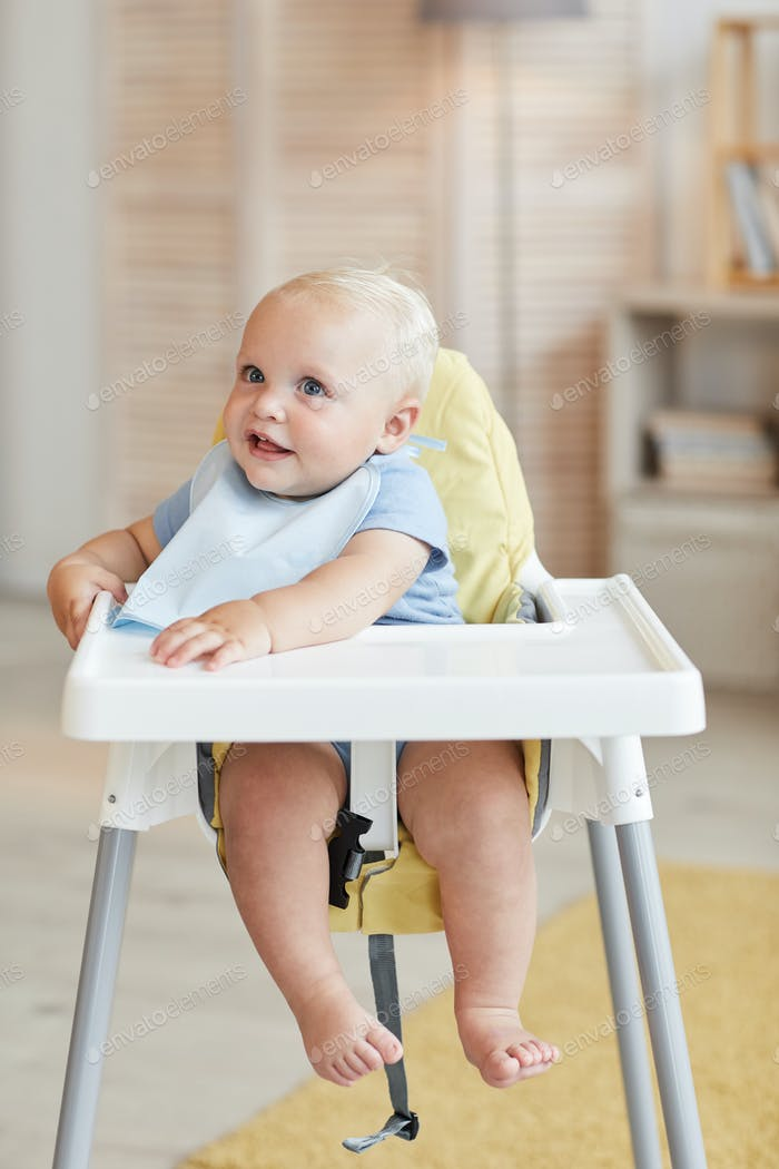 Baby Boy In Highchair