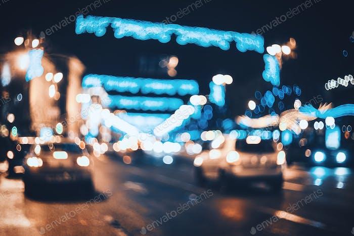 Verschwommene Stadt in der Nacht. Abstrakter Hintergrund mit Bokeh