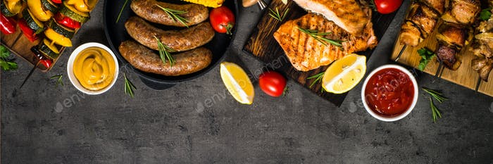 Barbeque dish - Grilled meat, fish, sausages and vegetables