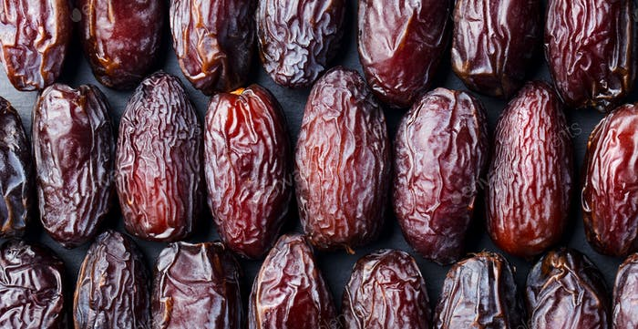 Fresh Medjool Dates Background. Healthy Organic Product. Top View. Close up.