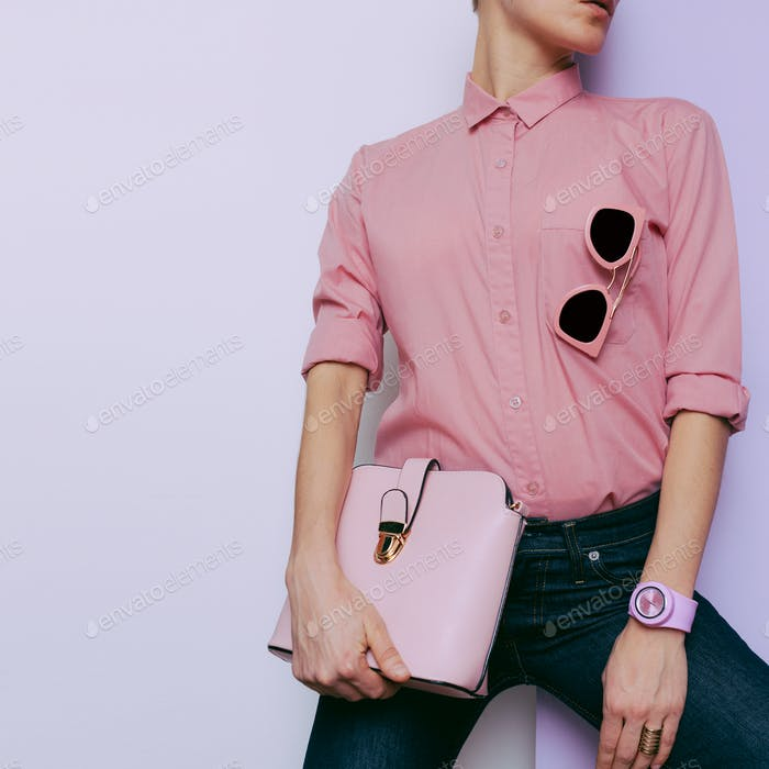 Girl in pink shirt and pink accessories. Watches, bags and sungl