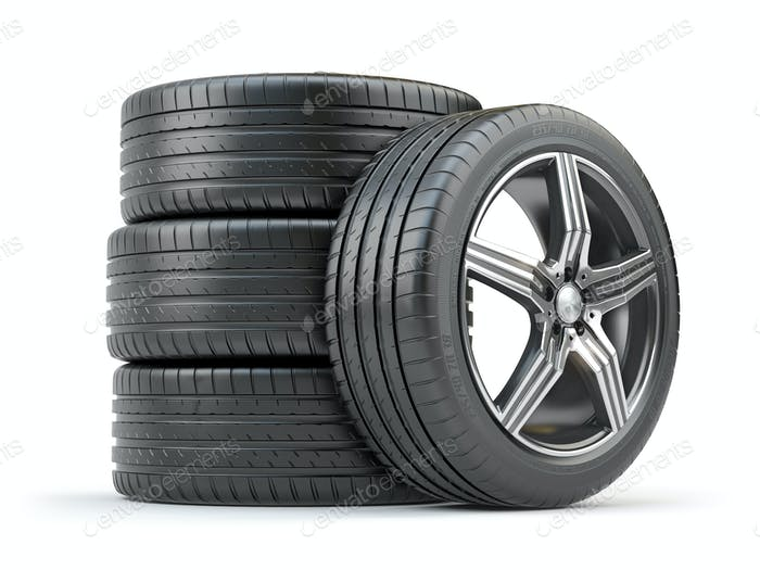 Car wheel on alloy disc with tyre isolated on white.