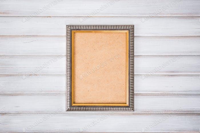 Vintage-Bilderrahmen auf Holzbrett Hintergrund Textur