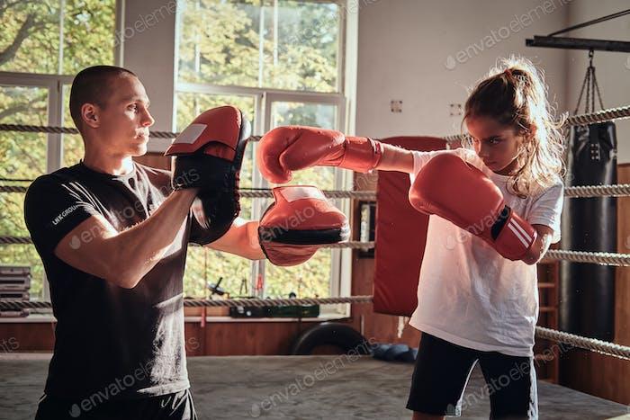 Training of little kick boxer girl