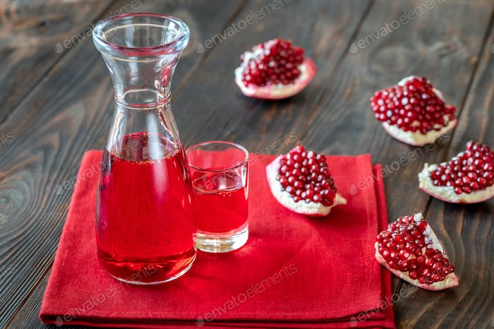 Glass jug of grenadine syrup