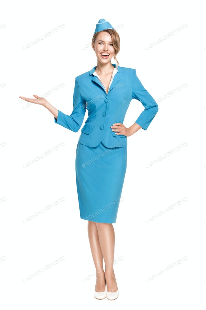 Portrait Of Charming Stewardess Wearing In Blue Uniform.