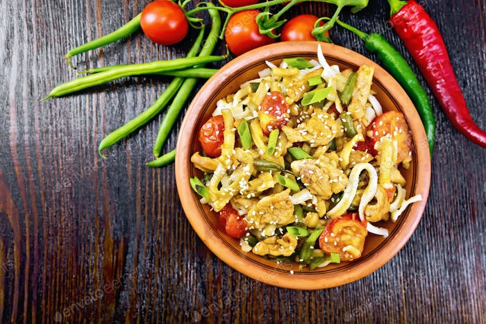 Noodles wok Thai in plate on board top