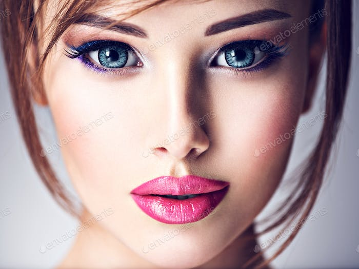 Attractive young woman with beautiful big blue eyes.
