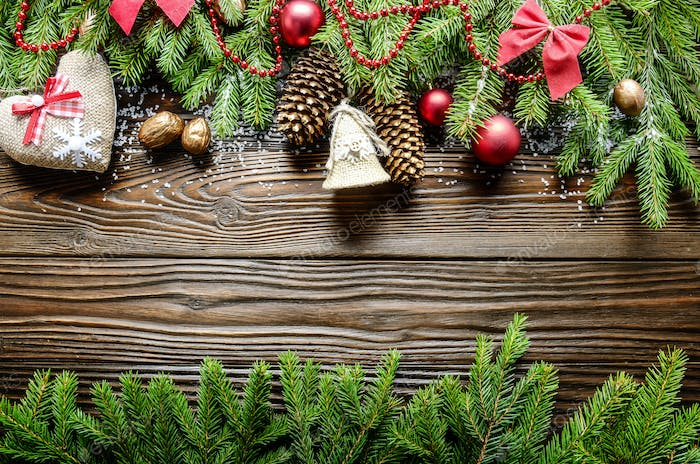 Flat lay Christmas border background of twigs, baubles and handm