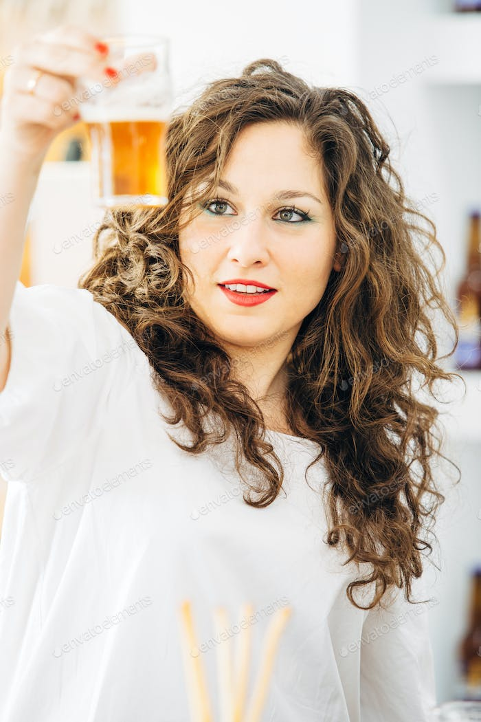 Portrait of woman looking at beer