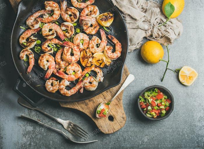 Grilled tiger prawns in pan with lemon, leek, chili, sauce