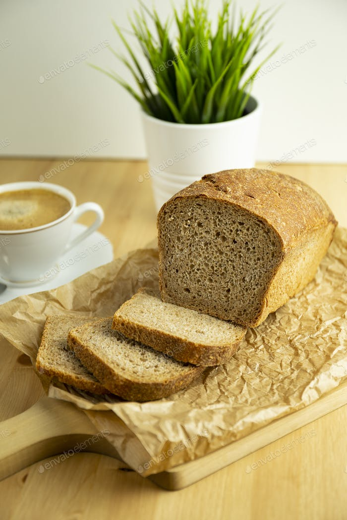 Spelt bread, coffee and plant