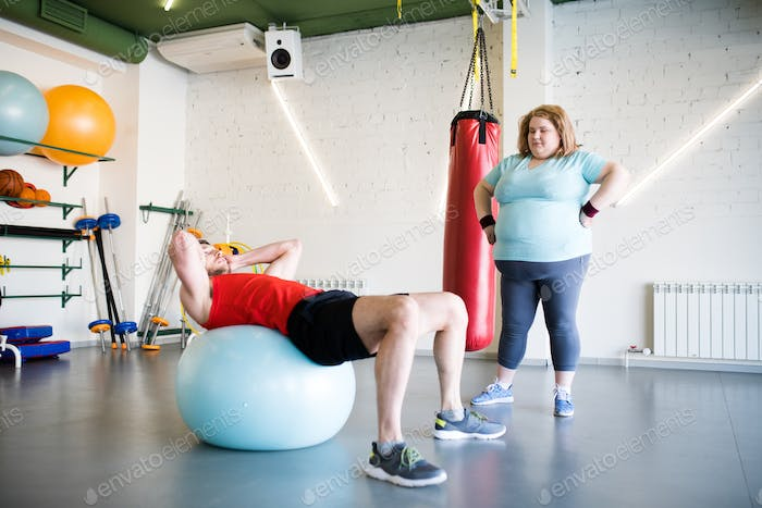 Obese Woman Training with Coach