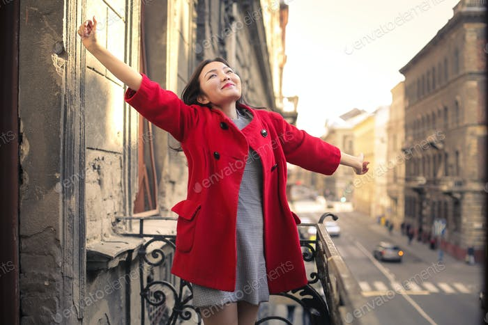 Happy woman on a balcony