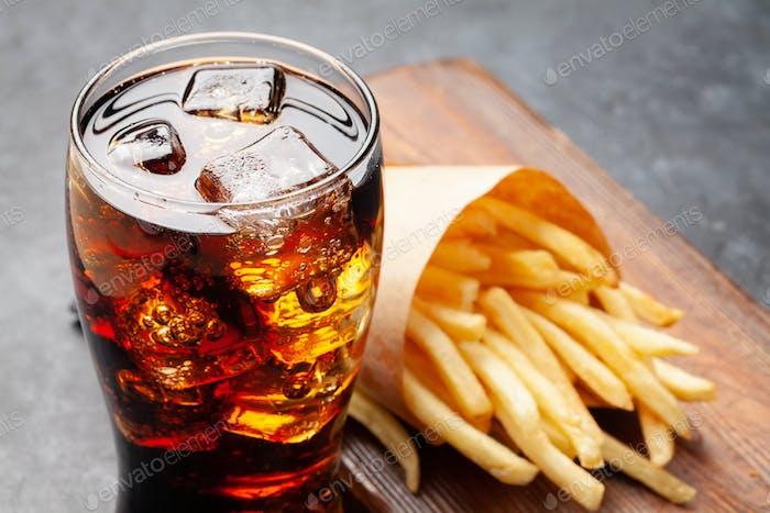 Glass of cola and crispy potato fries