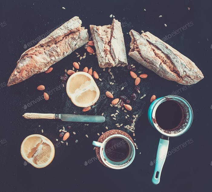 Rustic breakfast set of french baguette broken into pieces