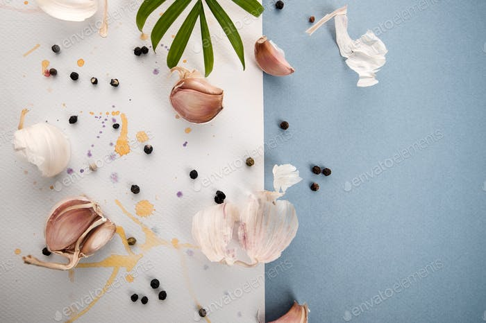 Garlic cloves on a beautiful watercolor background of white and