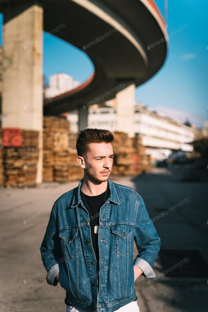 Urban young man posing