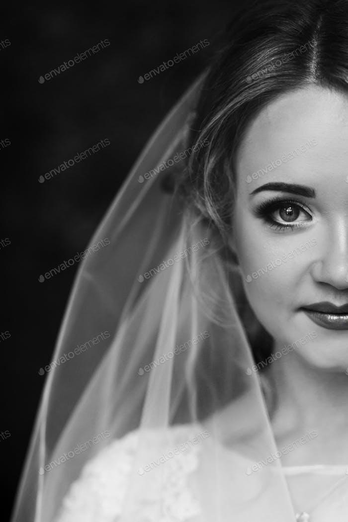 Beautiful blonde bride portrait, closeup of gorgeous newlywed woman
