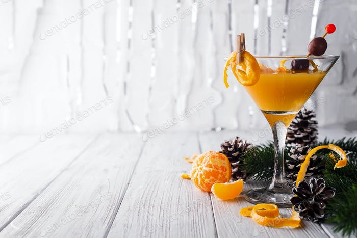 Mandarin martini in a glass of New Year