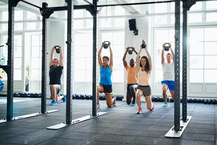 Diverse group of fit people working out at the gym