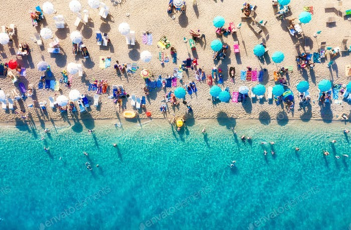 Air view of the beach with people. Holidays near the sea in the summertime