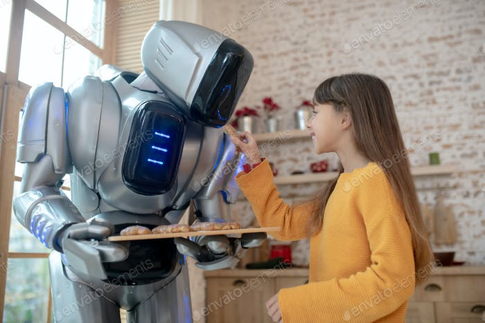 House robot offering meat balls to the girl