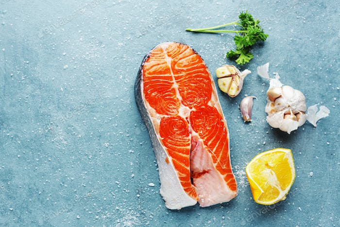 Raw fish steaks with ingredients