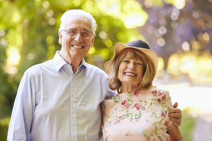 Portrait Of Senior Couple On Walk In Countryside Together