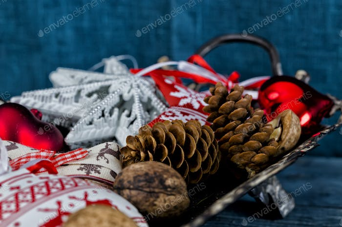 Christmas decoration on a metall tray over the blue wooden background