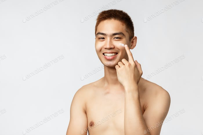 Beauty, people and leisure concept. Close-up portrait of pleased smiling asian man with naked torso