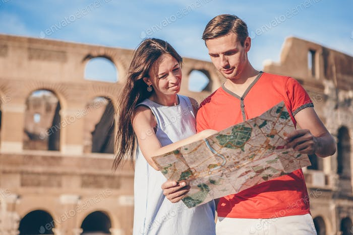 Happy family in Europe. Romantic couple in Rome over Coliseum background