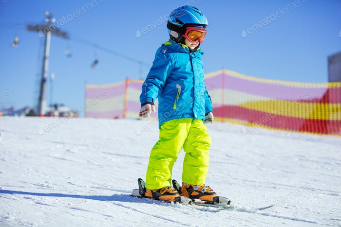Little boy skiing downhill
